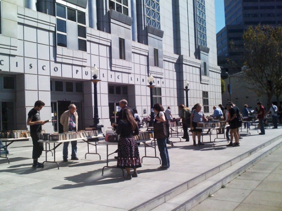 People rummage through the SF library book sale